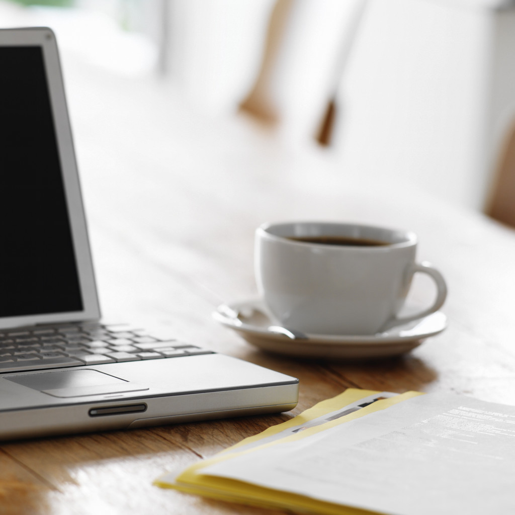 Laptop on kitchen table with cup of coffee business unplugged laptop on kitchen table with cup of coffee business unplugged carol roth geotapseo Gallery
