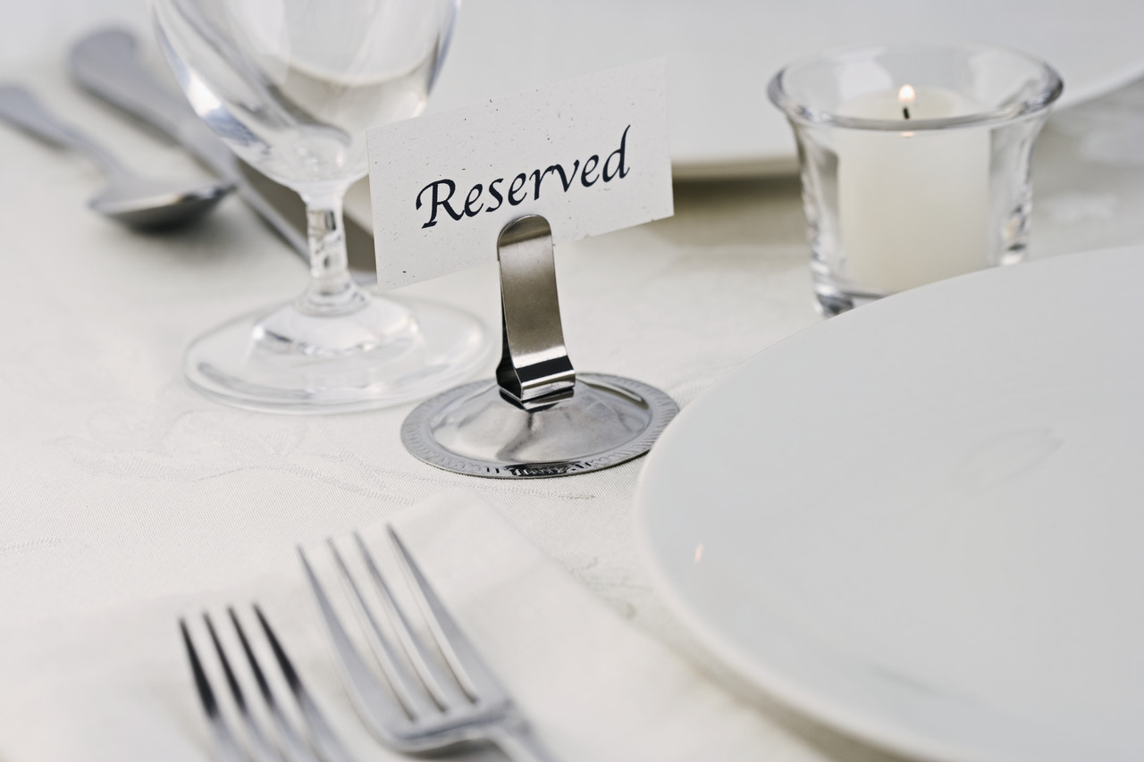 Table with reserved sign business unplugged carol roth for Fancy dinner table