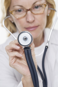 Physician Holding Out Stethoscope