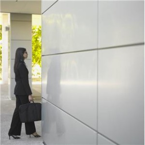 Woman suit by elevator